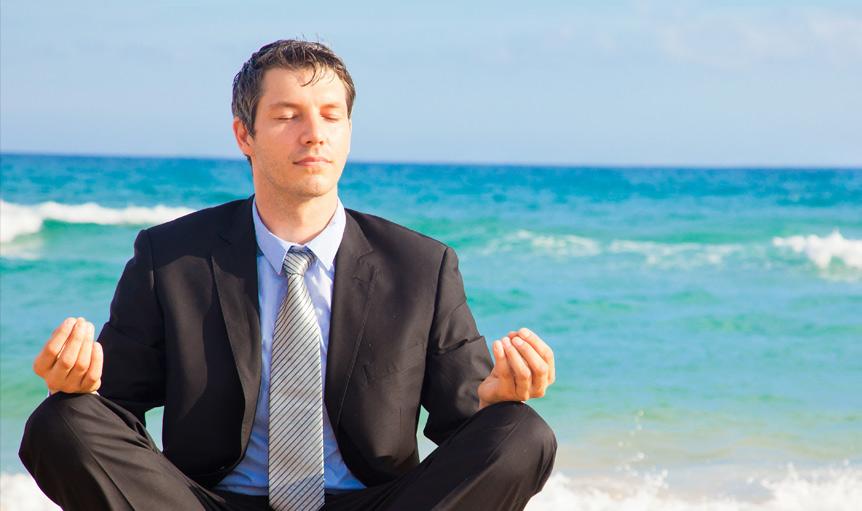 dean radin supernormal yoga man business suit beach